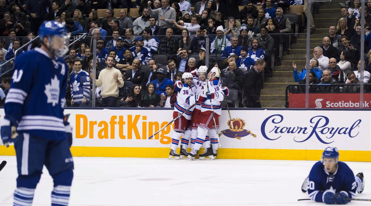 New York Rangers center Derek Stepan, center, celebrates his goal against the Toronto Maple Leafs with teammates during the third period of an NHL hockey game Thursday, Feb. 18, 2016, in Toronto. (Nathan Denette/The Canadian Press. via AP)
