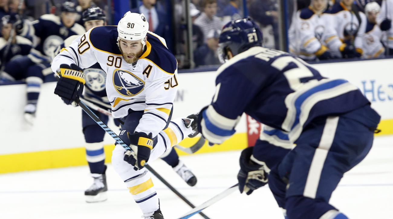 Buffalo Sabres' Ryan O'Reilly, left, shoots as Columbus Blue Jackets' Ryan Murray defends during the third period of an NHL hockey game Friday, Feb. 19, 2016, in Columbus, Ohio. The Sabres won 4-0. (AP Photo/Jay LaPrete)