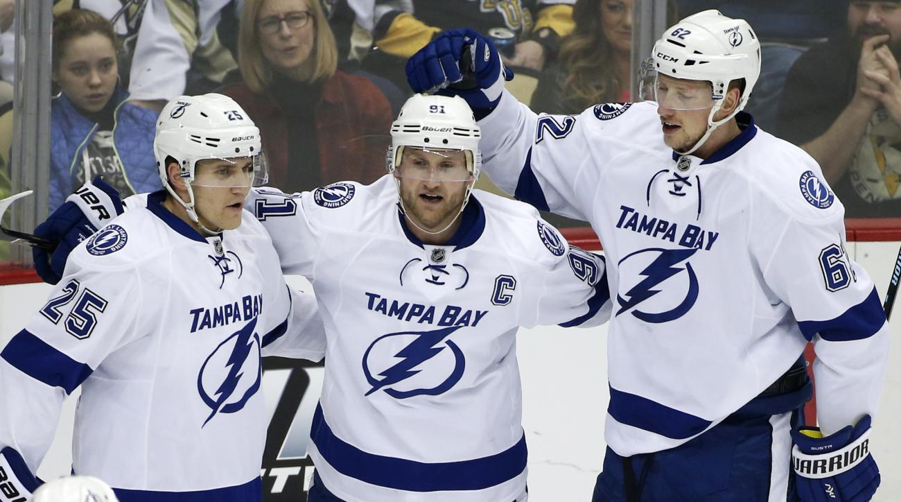 Tampa Bay Lightning's Steven Stamkos (91) celebrates his goal with teammates Matt Carle (25) and Andrej Sustr (62) during the first period of an NHL hockey game against the Pittsburgh Penguins in Pittsburgh, Saturday, Feb. 20, 2016. (AP Photo/Gene J. Pusk