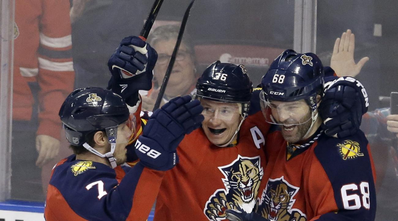 Florida Panthers right wing Jaromir Jagr (68) celebrates with teammates Jussi Jokinen (36) and Dmitry Kulikov (7) after scoring against the Winnipeg Jets during the second period of an NHL hockey game, Saturday, Feb. 20, 2016, in Sunrise, Fla. (AP Photo/A