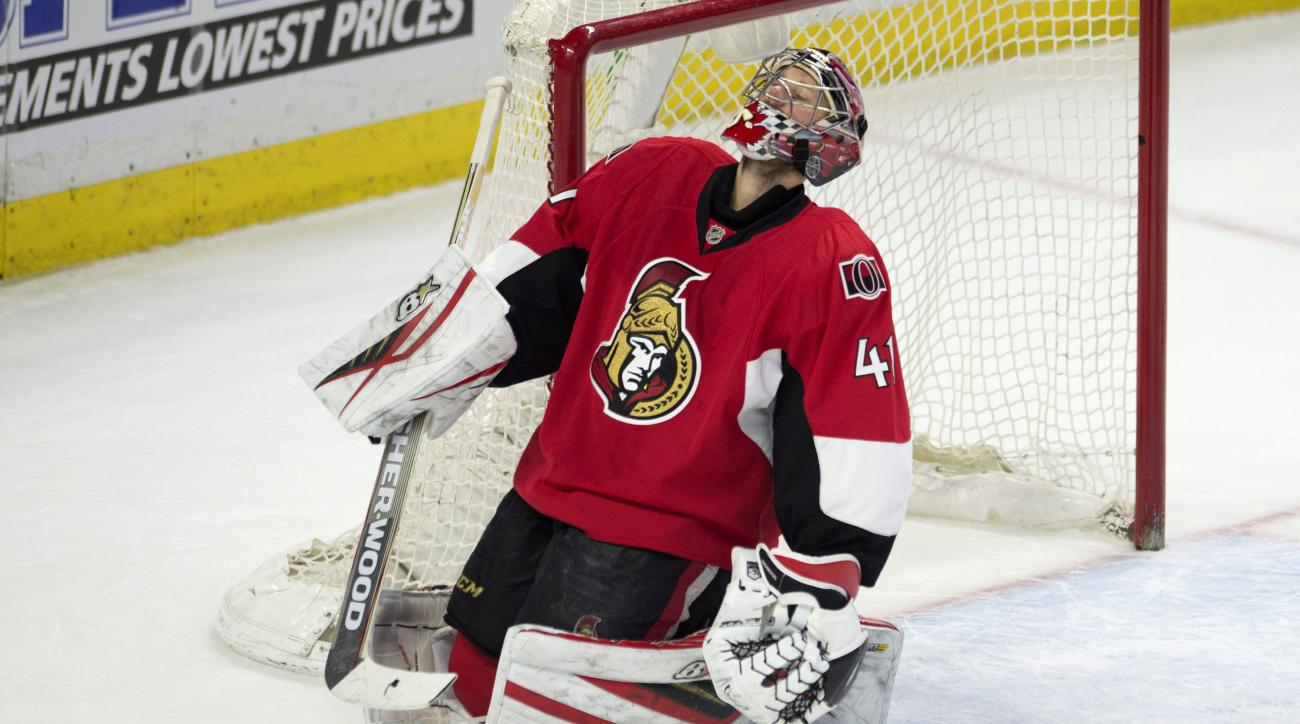 Ottawa Senators' goalie Craig Anderson reacts after allowing a goal delivered by the Detroit Red Wings during the second period of an NHL hockey game in Ottawa, Ontario, on Saturday, Feb. 20, 2016. (Adrian Wyld /The Canadian Press via AP) MANDATORY CREDIT