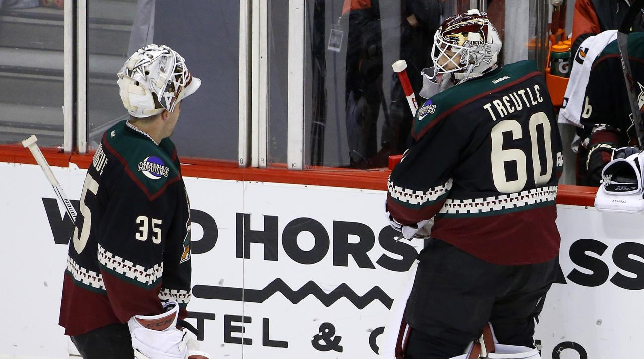 After giving up four goals to the St. Louis Blues, Arizona Coyotes' Louis Domingue (35) is replaced by Niklas Treutle (60), of Germany, during the first period of an NHL hockey game Saturday, Feb. 20, 2016, in Glendale, Ariz. (AP Photo/Ross D. Franklin)