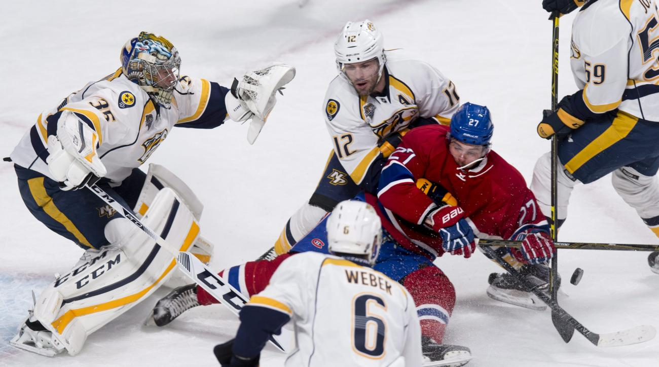 Montreal Canadiens' Alex Galchenyuk (27) is taken down by Nashville Predators' Mike Fisher (12) in front of goalie Pekka Rinne as Shea Weber (6) looks on during first-period NHL hockey game action in Montreal, Monday, Feb. 22, 2016. (Paul Chiasson/The Can