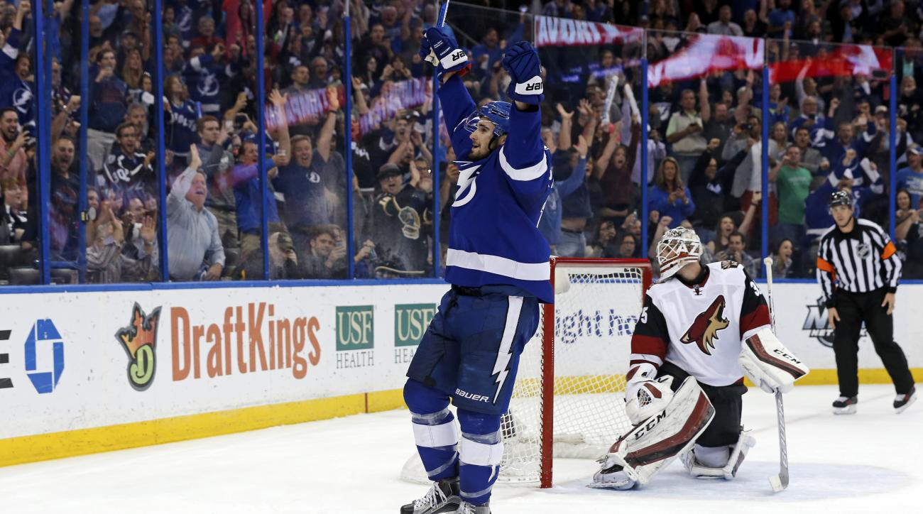 Tampa Bay Lightning's Cedric Paquette celebrates a penalty shot goal against Arizona Coyotes' Louis Domingue during the second period of an NHL hockey game Tuesday, Feb. 23, 2016, in Tampa, Fla. (AP Photo/Mike Carlson)