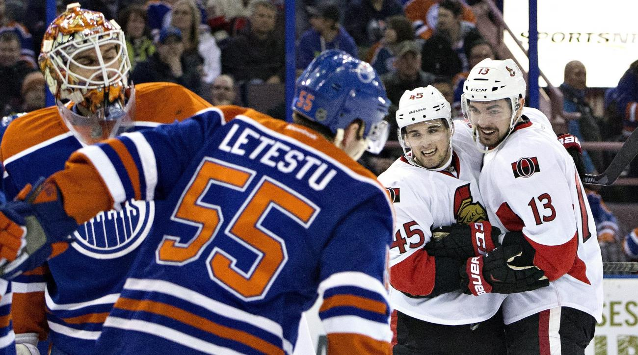 Ottawa Senators' Chris Wideman (45) and Nick Paul (13) celebrate a goal on Edmonton Oilers goalie Cam Talbot (33) as Mark Letestu (55) skates past during first period of an NHL hockey game in Edmonton, Alberta, Tuesday, Feb. 23, 2016. (Jason Franson/The C