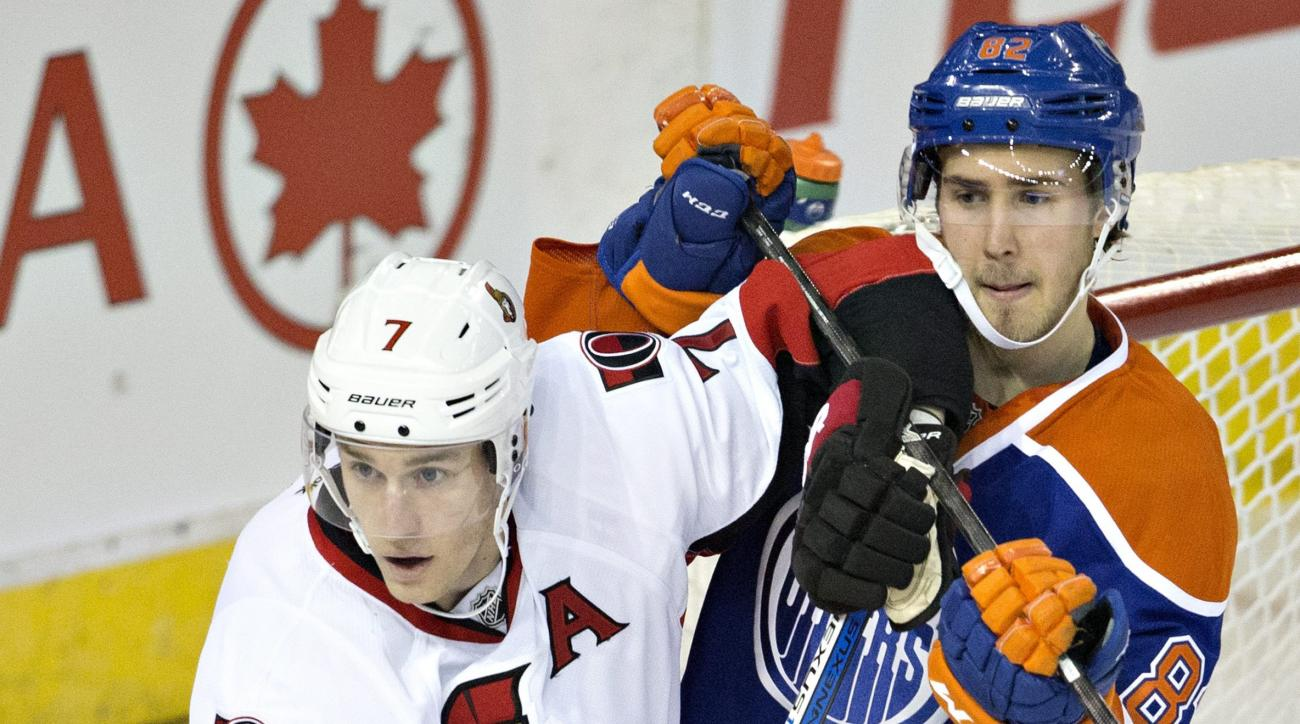 Ottawa Senators' Kyle Turris (7) and Edmonton Oilers' Jordan Oesterle (82) battle in front of the net during second period of an NHL hockey game in Edmonton, Alberta, Tuesday, Feb. 23, 2016. (Jason Franson/The Canadian Press via AP) MANDATORY CREDIT