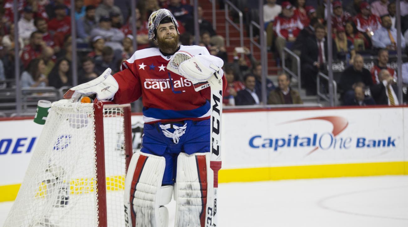 Washington Capitals goalie Braden Holtby looks off after giving up a goal to the Montreal Canadiens during the first period of an NHL hockey game, on Wednesday, Feb. 24, 2016, in Washington. (AP Photo/Evan Vucci)
