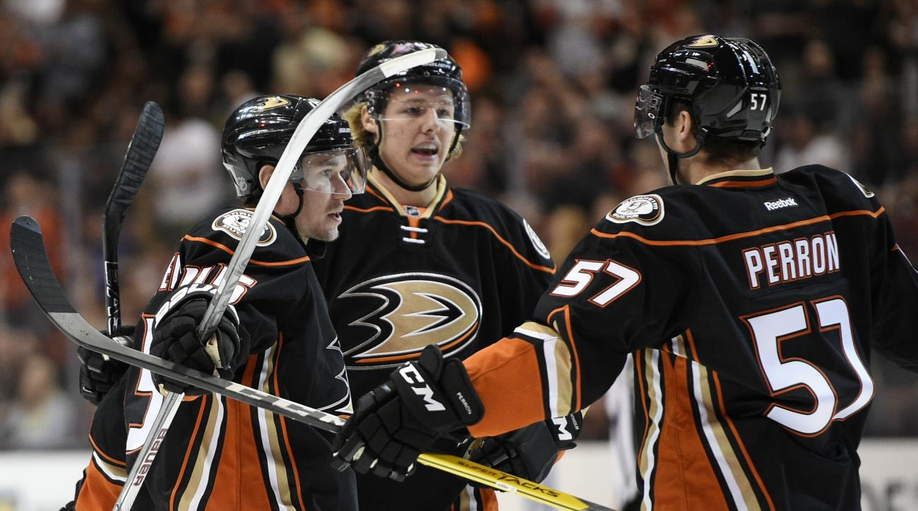 Anaheim Ducks defenseman Sami Vatanen, left, of Finland, celebrates with defenseman Hampus Lindholm, center, of Sweden, and left wing David Perron after Vatanen scored a goal during the second period of an NHL hockey game against the Buffalo Sabres in Ana