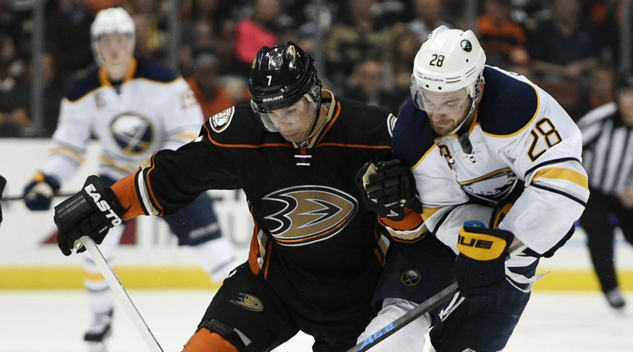Anaheim Ducks left wing Andrew Cogliano, left, and Buffalo Sabres center Zemgus Girgensons, right, race for the puck during the second period of an NHL hockey game in Anaheim, Calif., Wednesday, Feb. 24, 2016. (AP Photo/Kelvin Kuo)