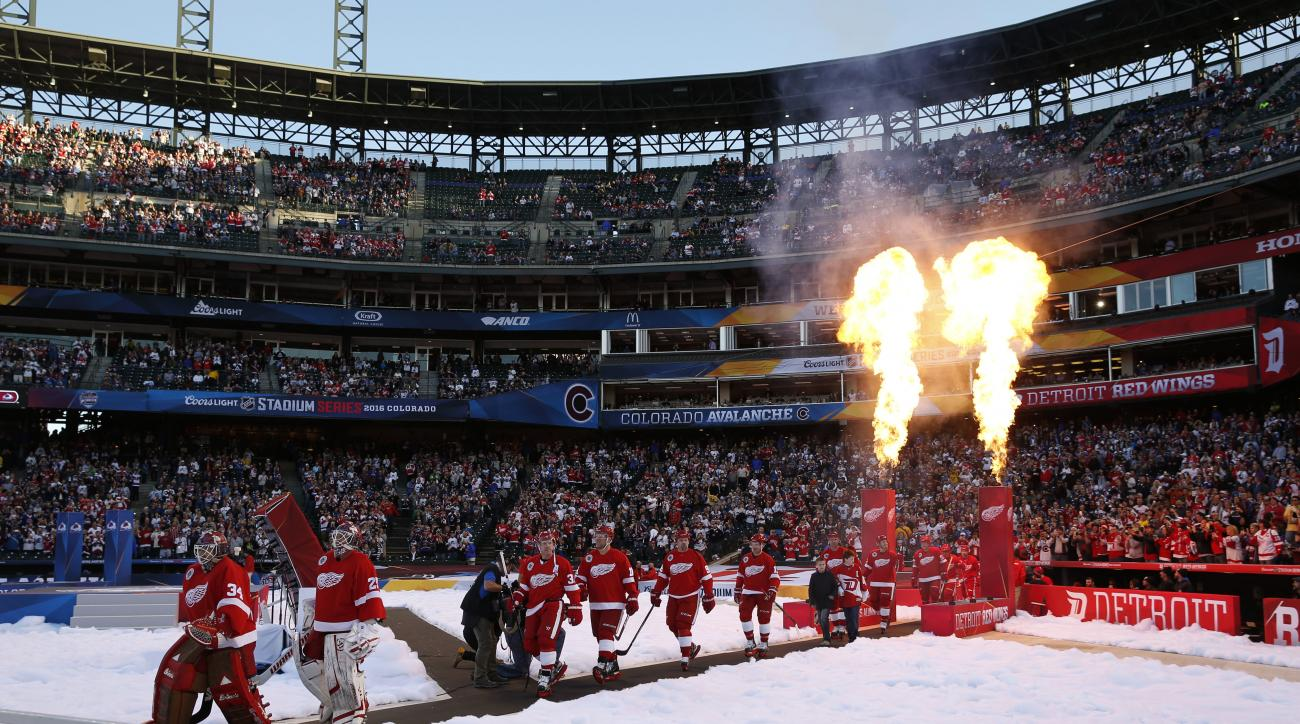 Detroit Red Wings take the ice to face the Colorado Avalanche in the Stadium Series alumni hockey game at Coors Field in Denver on Friday, Feb. 26, 2016. Colorado won 5-2. (AP Photo/David Zalubowski)