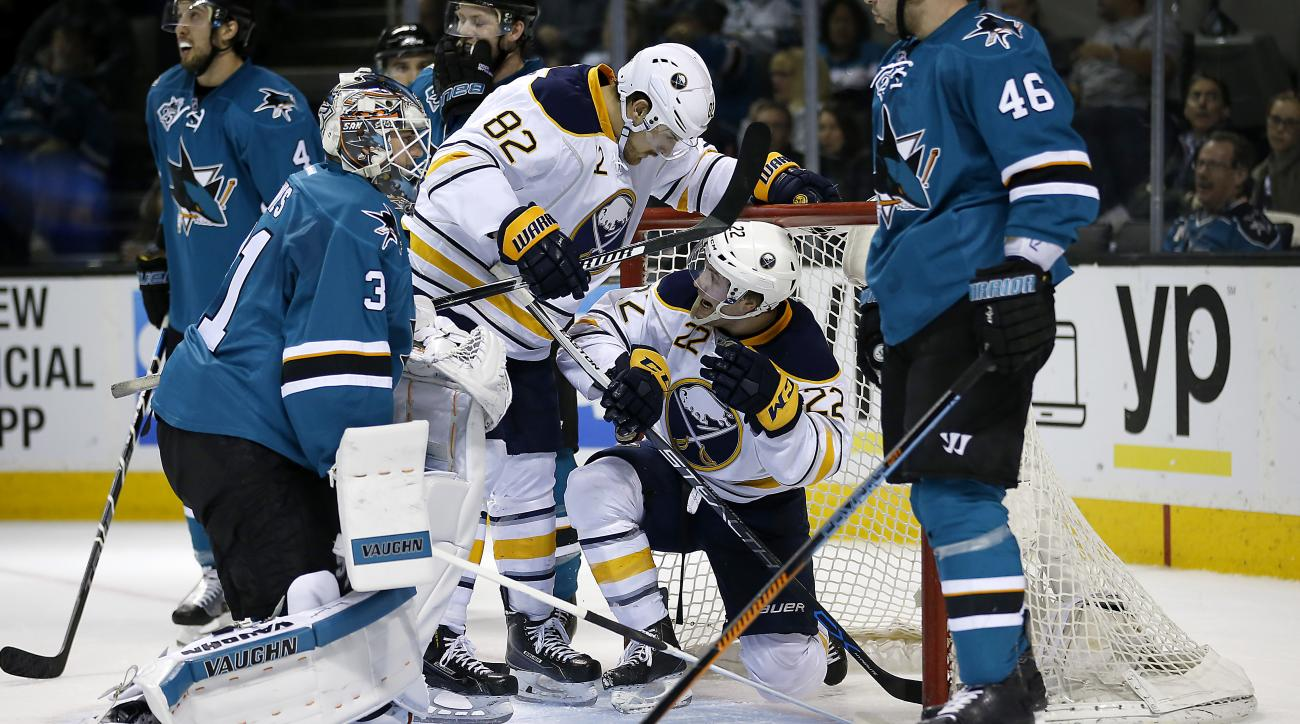 Buffalo Sabres left wing Johan Larsson (22) celebrates with teammate Marcus Foligno (82) after scoring a goal past San Jose Sharks goalie Martin Jones, left, during the second period of an NHL hockey game Friday, Feb. 26, 2016, in San Jose, Calif. (AP Pho