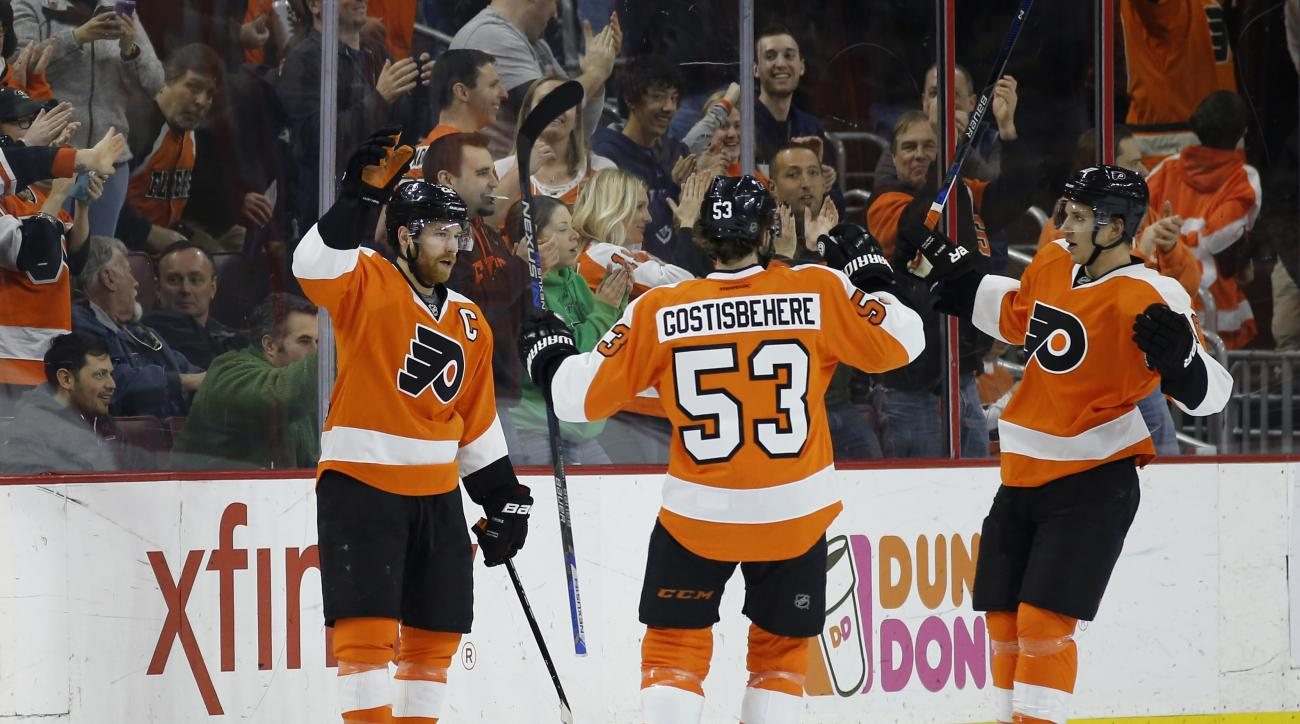 Philadelphia Flyers' Claude Giroux, left, Shayne Gostisbehere and Brayden Schenn celebrate after Giroux's goal during the first period of an NHL hockey game against the Arizona Coyotes, Saturday, Feb. 27, 2016, in Philadelphia. Philadelphia won 4-2. (AP P