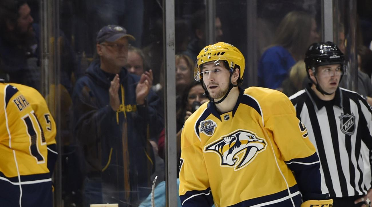 Nashville Predators center Filip Forsberg (9), of Sweden, watches as hats float to the ice after he scored a hat trick against the St. Louis Blues in the second period of an NHL hockey game Saturday, Feb. 27, 2016, in Nashville, Tenn. (AP Photo/Sanford My