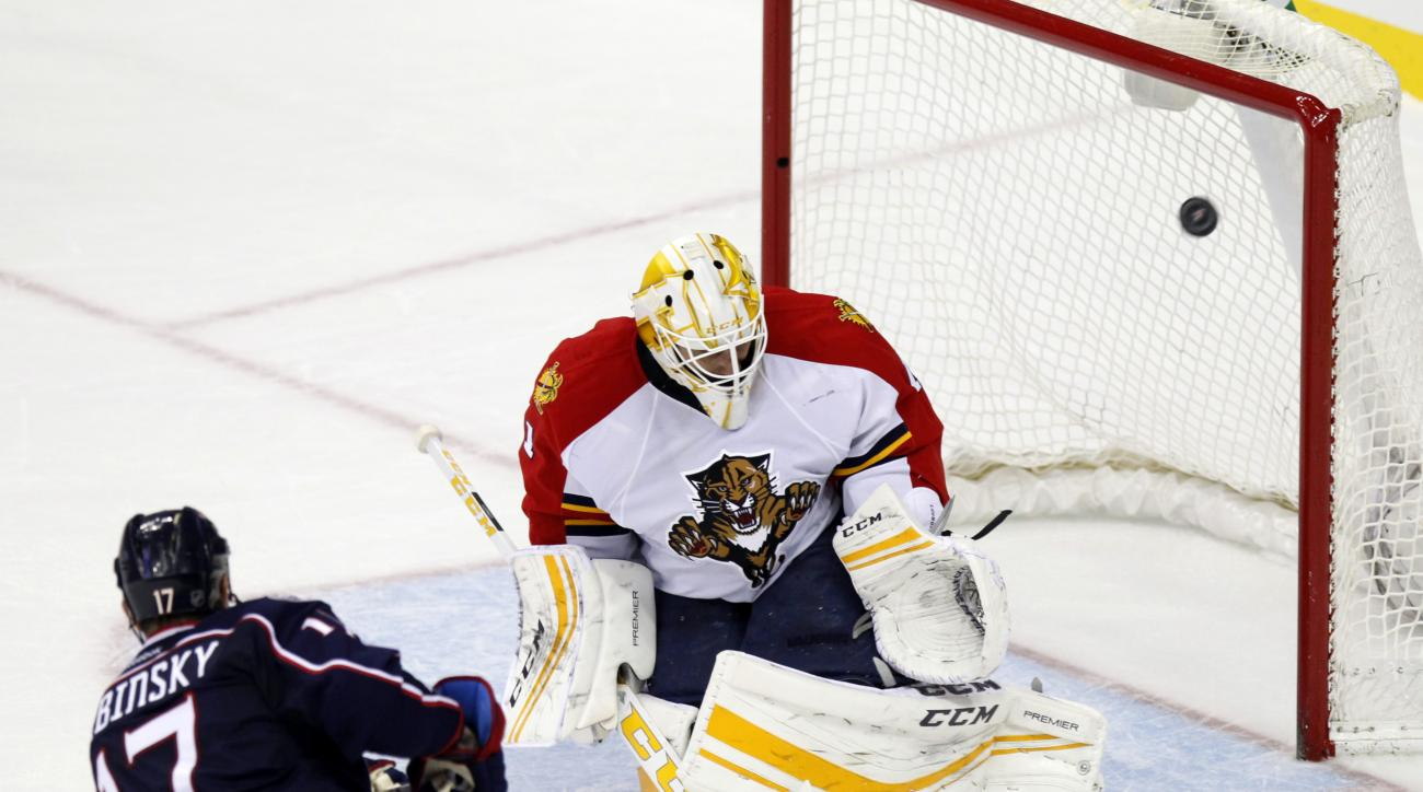Columbus Blue Jackets' Brandon Dubinsky, left, scores the game winning goal against Florida Panthers goalie Roberto Luongo during a shootout of an NHL hockey game in Columbus, Ohio,  Saturday, Feb. 27, 2016. The Blue Jackets won 4-3. (AP Photo/Paul Vernon