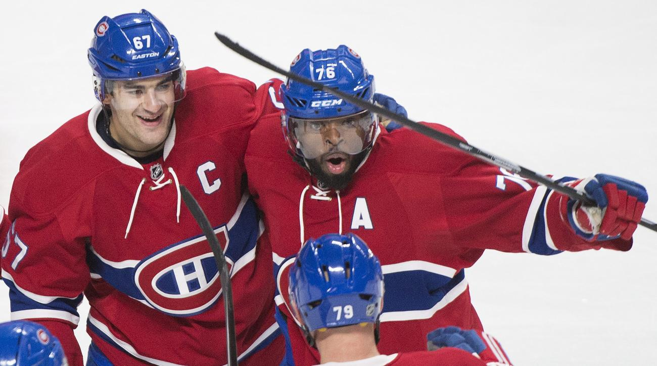 Montreal Canadiens captain Max Pacioretty (67) celebrates with teammates P.K. Subban (76) and Andrei Markov (79) after scoring against the Toronto Maple Leafs during third-period NHL hockey game action in Montreal, Saturday, Feb. 27, 2016. (Graham Hughes/