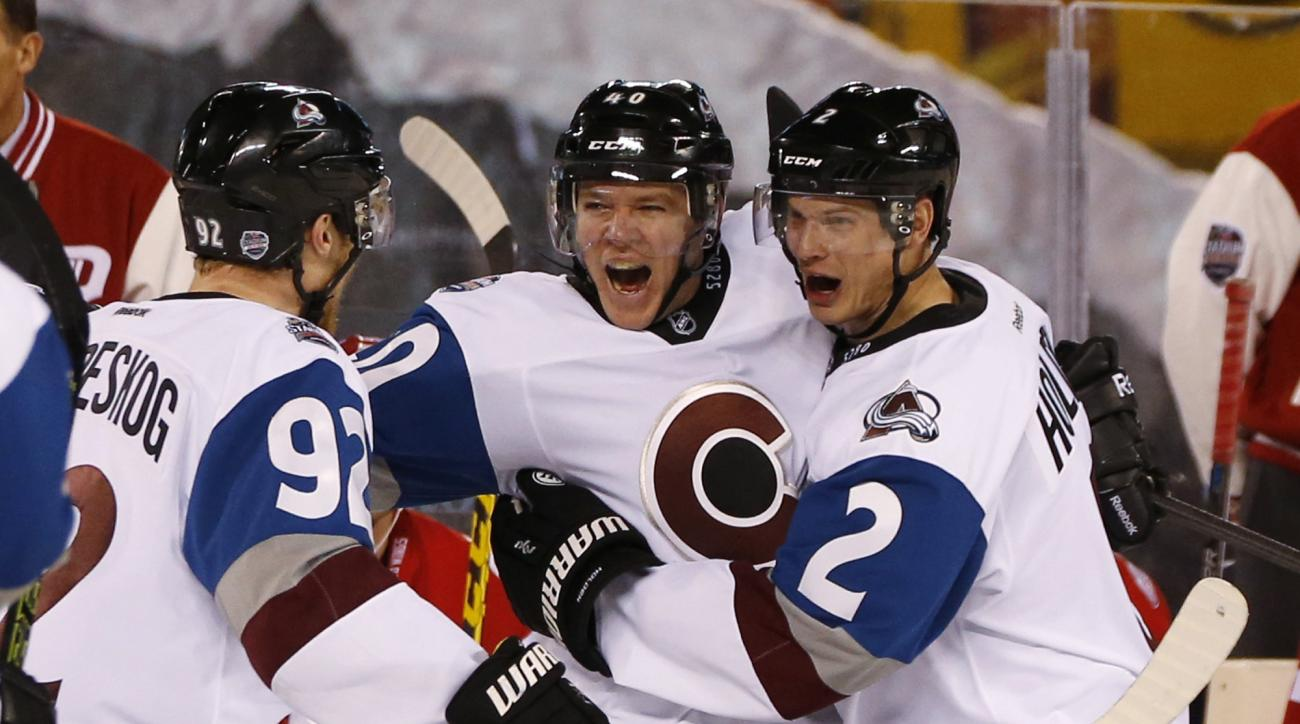 Colorado Avalanche left wing Alex Tanguay, center, celebrates his goal with left wing Gabriel Landeskog, left, and defenseman Nick Holden, against the Detroit Red Wings during the third period of an NHL hockey game at Coors Field on Saturday, Feb. 27, 201