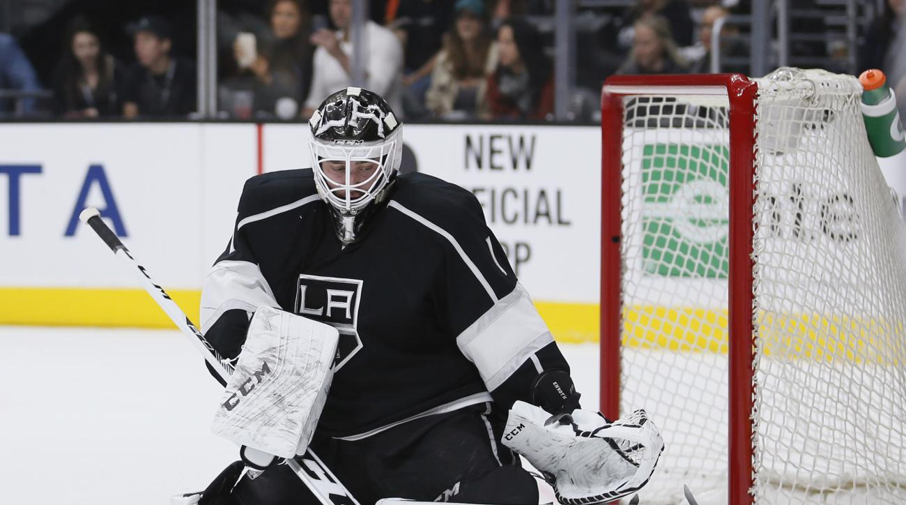 Los Angeles Kings goalie Jhonas Enroth makes a save against the Buffalo Sabres during the first period of an NHL hockey game Saturday, Feb. 27, 2016, in Los Angeles. (AP Photo/Danny Moloshok)