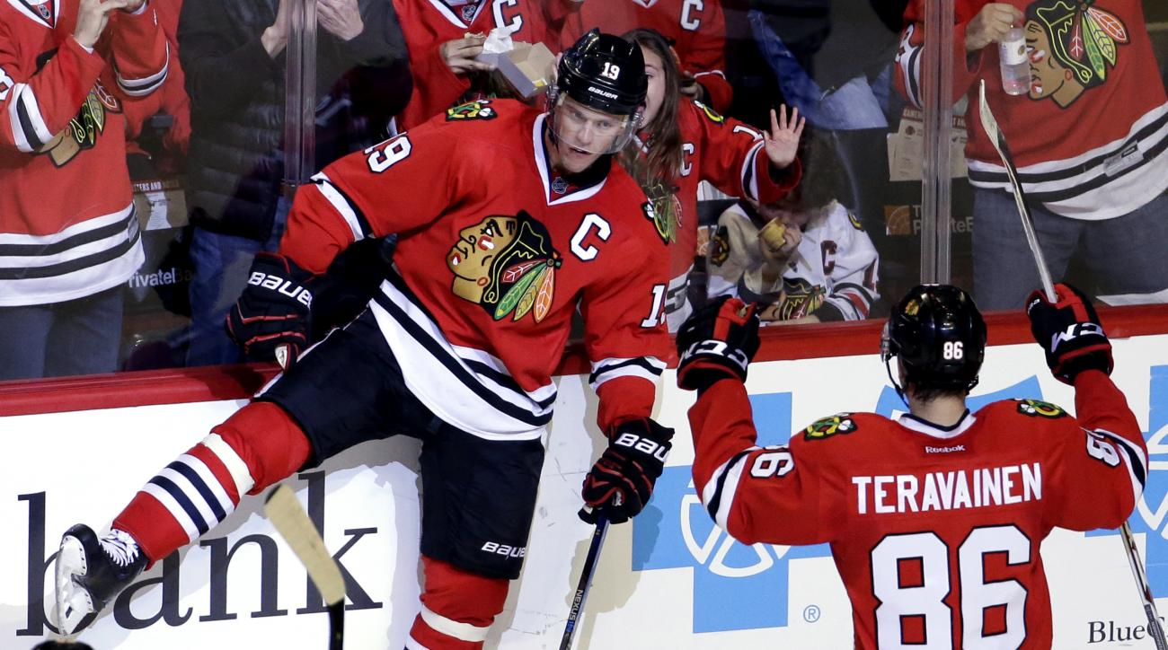 Chicago Blackhawks center Jonathan Toews (19) celebrates with center Teuvo Teravainen (86) after scoring his goal against the Washington Capitals during the second period of an NHL hockey game Sunday,Feb. 28, 2016, in Chicago. (AP Photo/Nam Y. Huh)
