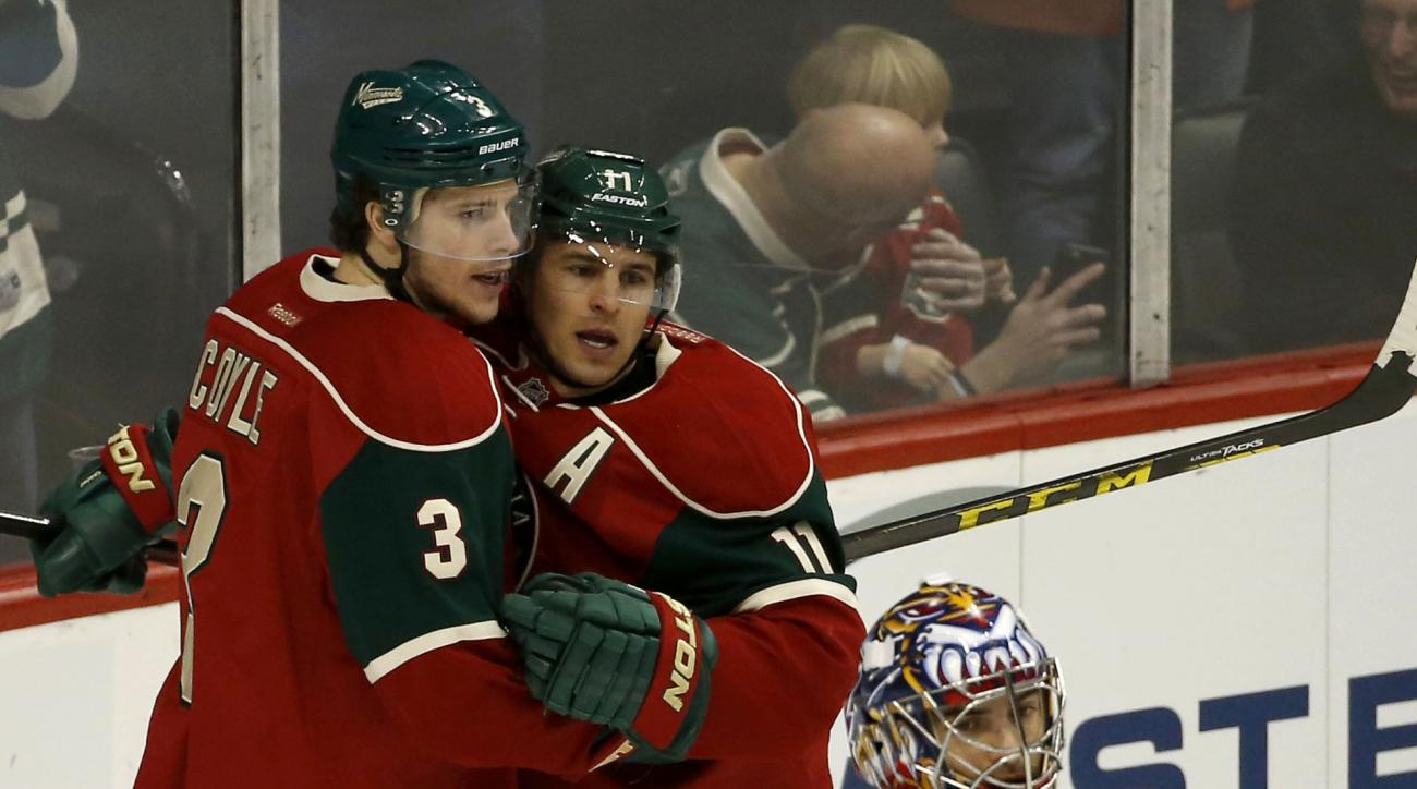 Minnesota Wild center Charlie Coyle (3) and Wild left wing Zach Parise, right, celebrate a goal by Coyle as Florida Panthers goalie Al Montoya (35) looks away during the first period of an NHL hockey game in St. Paul, Minn., Sunday, Feb. 28, 2016. (AP Pho