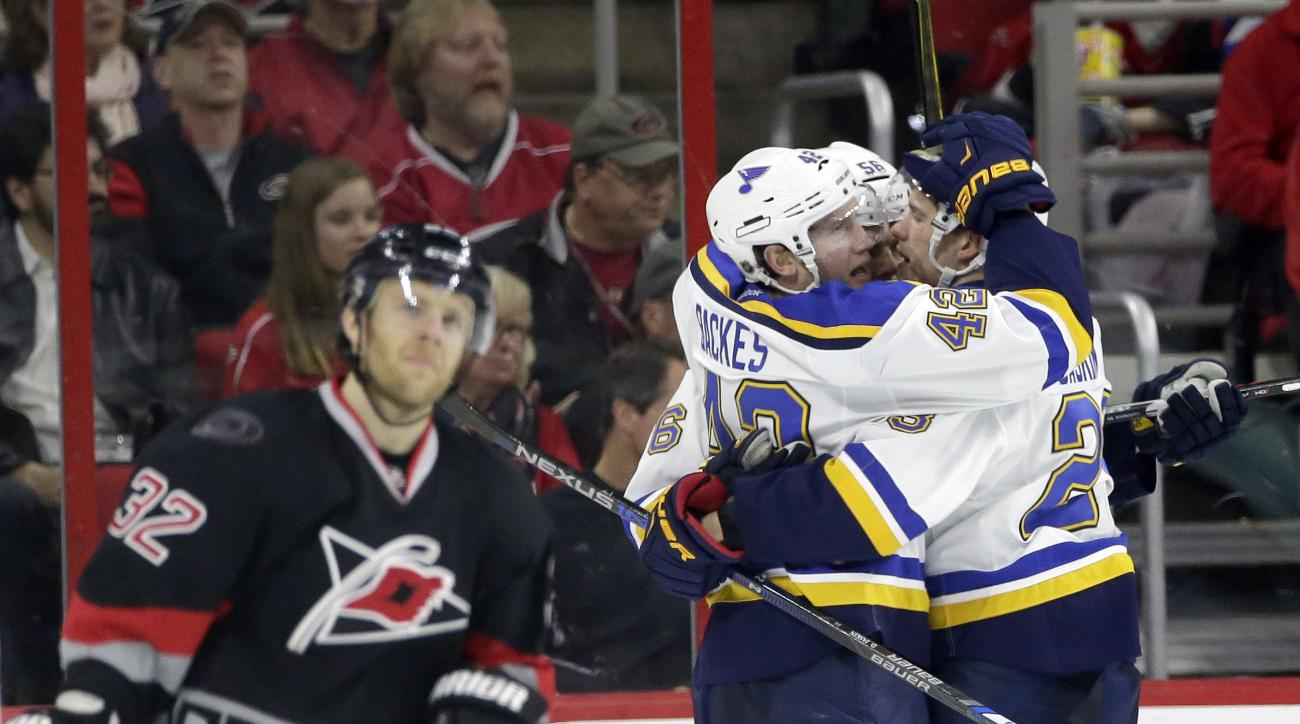 Carolina Hurricanes' Kris Versteeg (32) skates away as St. Louis Blues' David Backes (42), Magnus Paajarvi, of Sweden, and Kyle Brodziak, right, celebrate Backes' goal during the second period of an NHL hockey game in Raleigh, N.C., Sunday, Feb. 28, 2016.