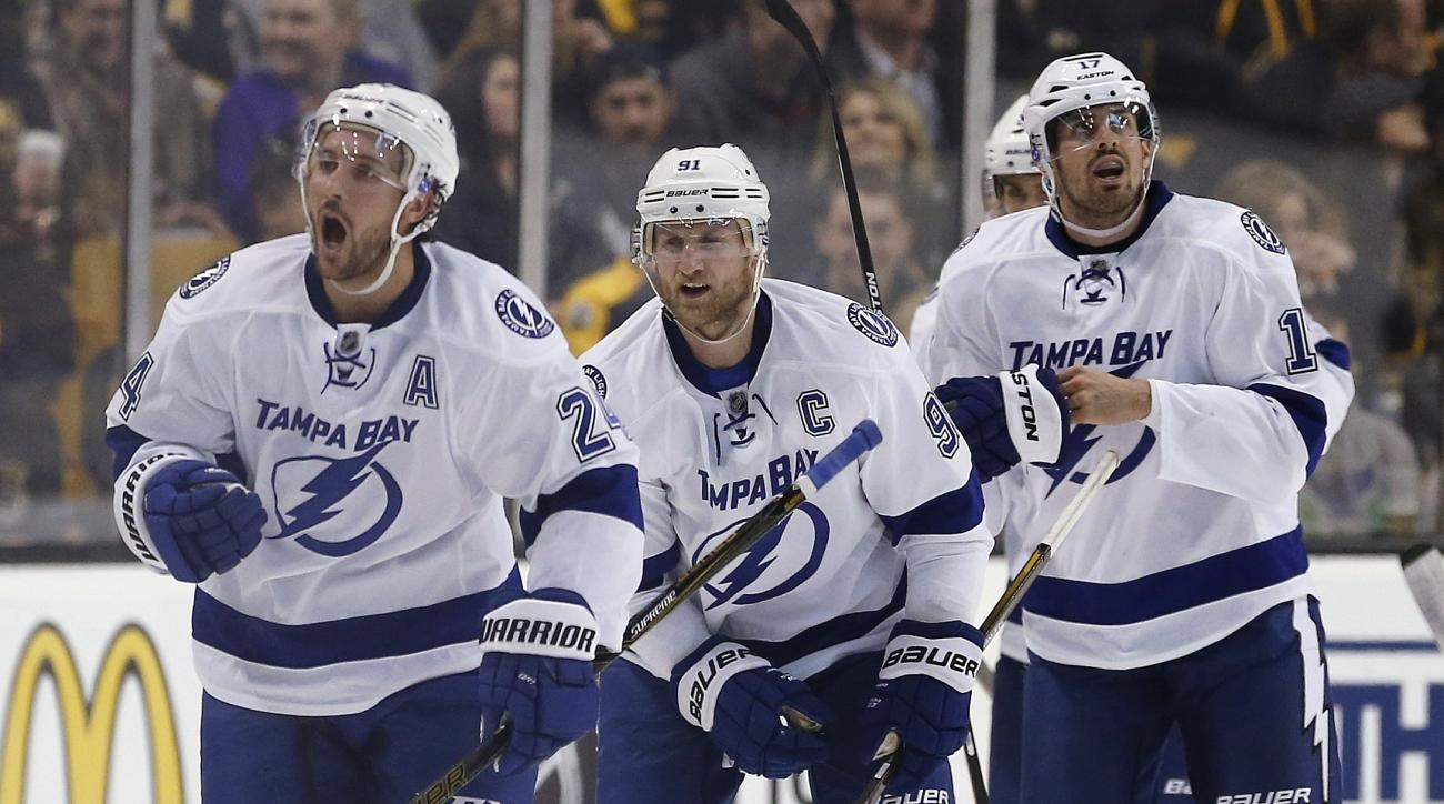 Tampa Bay Lightning's Ryan Callahan (24) celebrates his goal in front of teammates Steven Stamkos (91) and Alex Killorn (17) during the second period of an NHL hockey game against the Boston Bruins in Boston, Sunday, Feb. 28, 2016. (AP Photo/Michael Dwyer