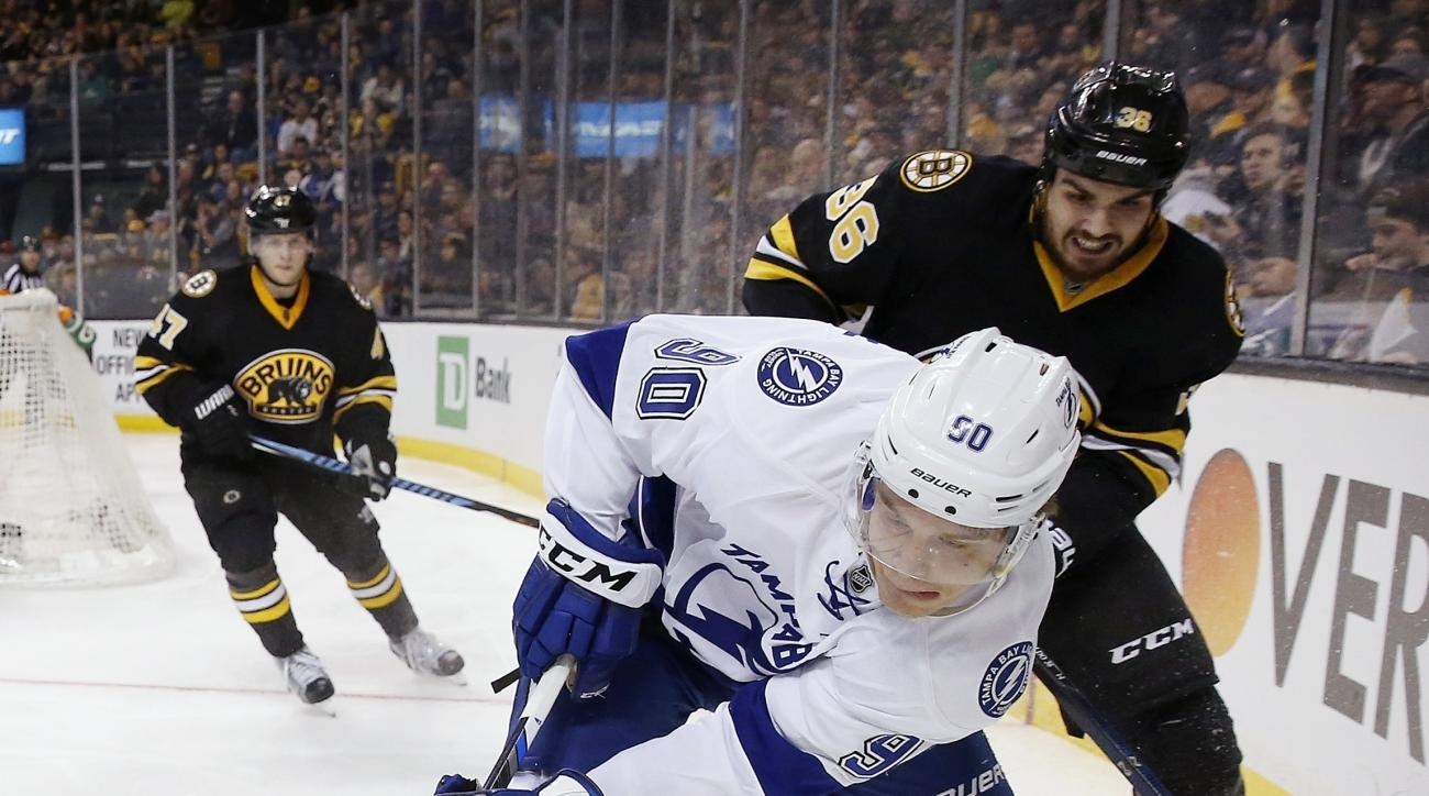 Tampa Bay Lightning's Vladislav Namestnikov (90) and Boston Bruins' Zac Rinaldo (36) battle for the puck during the third period of an NHL hockey game in Boston, Sunday, Feb. 28, 2016. The Lightning won 4-1. (AP Photo/Michael Dwyer)