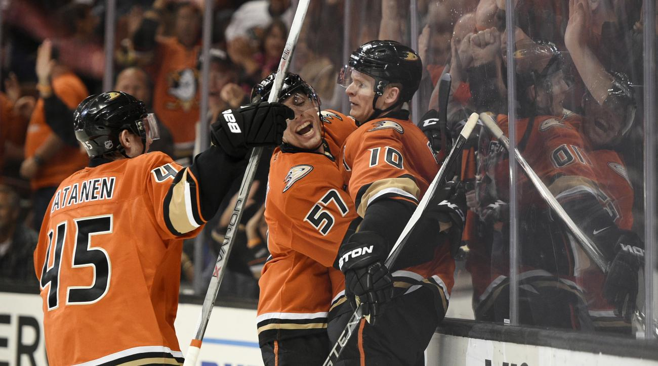Anaheim Ducks right wing Corey Perry celebrates his goal with left wing David Perron, center, and defenseman Sami Vatanen, left, of Finland, during the second period of an NHL hockey game against the Los Angeles Kings in Anaheim, Calif., Sunday, Feb. 28,