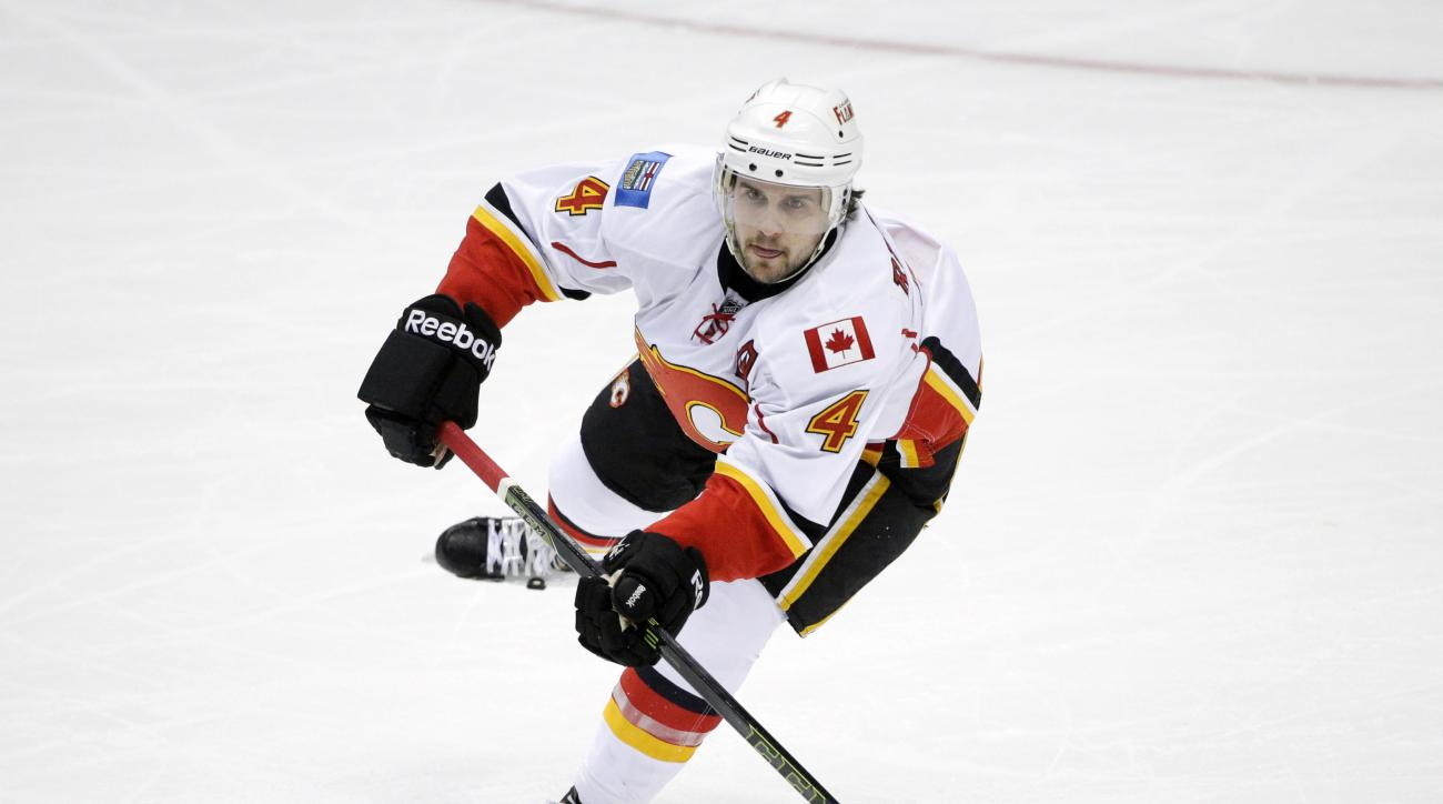 FILE - In this Nov. 24, 2015, file photo, Calgary Flames' Kris Russell moves the puck during the first period of an NHL hockey game against the Anaheim Ducks, in Anaheim, Calif. The Dallas Stars paid a big price to improve their defense, Monday, Feb. 29,