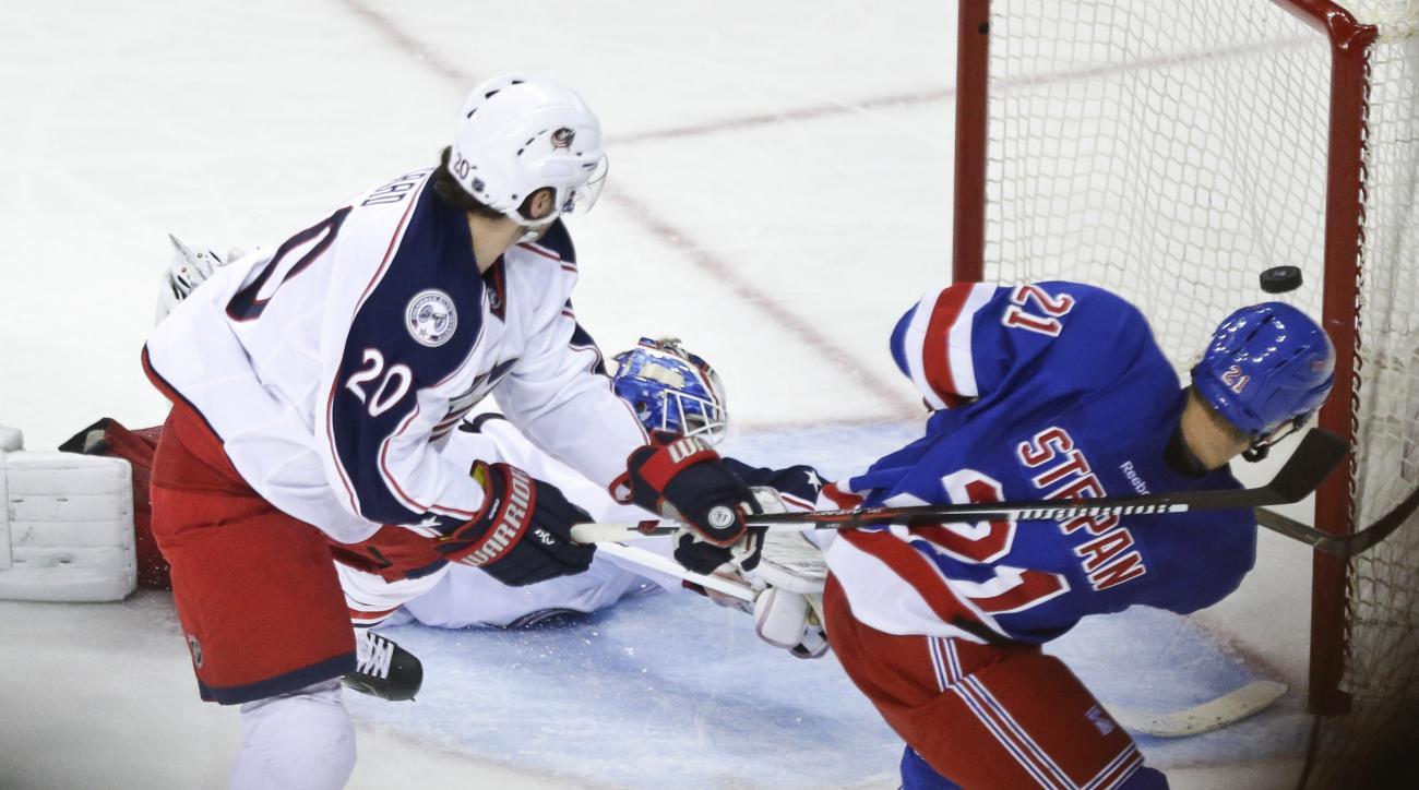 New York Rangers' Derek Stepan (21) shoots the puck past Columbus Blue Jackets goalie Joonas Korpisalo to score the game winning goal during the third period of an NHL hockey game Monday, Feb. 29, 2016, in New York. The Rangers won 2-1.(AP Photo/Frank Fra