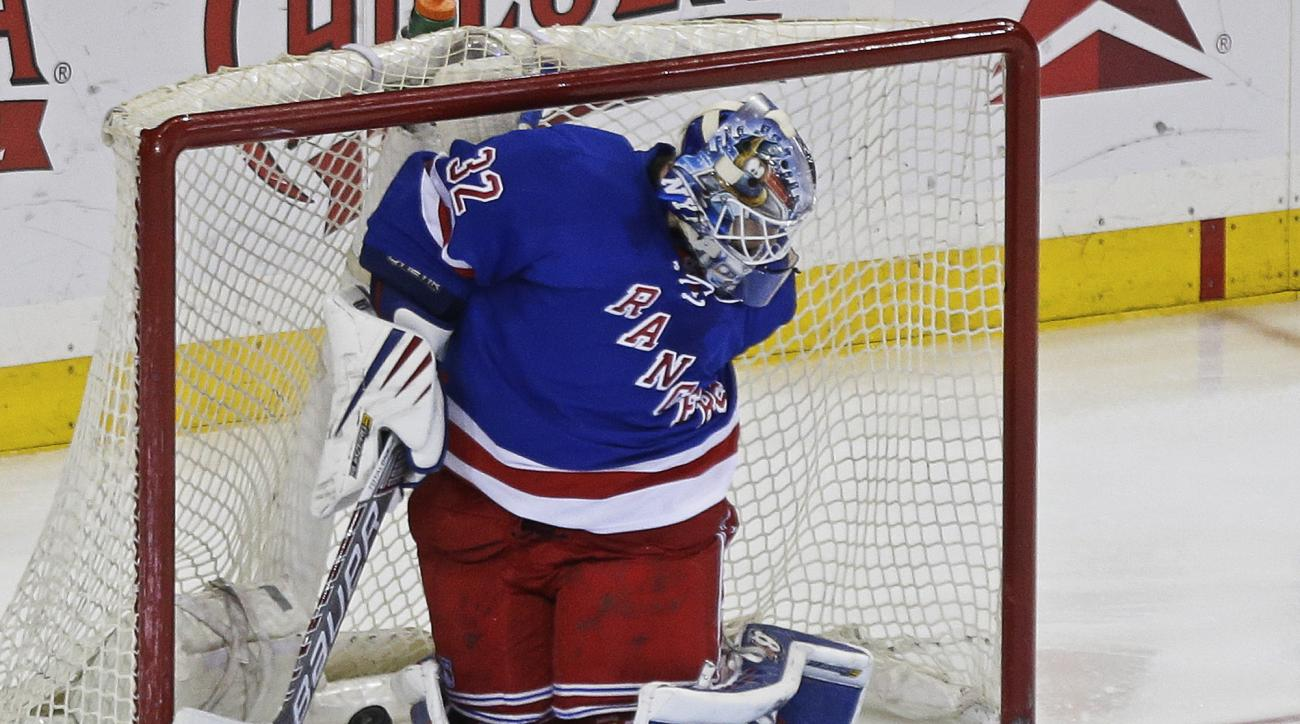 New York Rangers goalie Antti Raanta (32) reacts after a puck shot by Columbus Blue Jackets' Cam Atkinson gets past him for a goal during the third period of an NHL hockey game Monday, Feb. 29, 2016, in New York. The Rangers won 2-1.(AP Photo/Frank Frankl