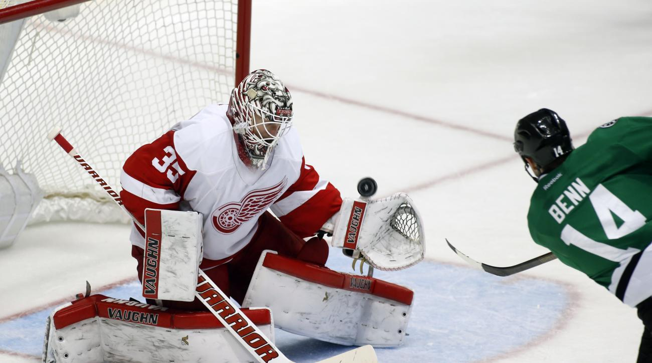 Detroit Red Wings goalie Jimmy Howard (35) make s save on a shot by Dallas Stars left wing Jamie Benn (14) during the third period of an NHL hockey game Monday, Feb. 29, 2016, in Dallas. Detroit won 3-2. (AP Photo/Sharon Ellman)