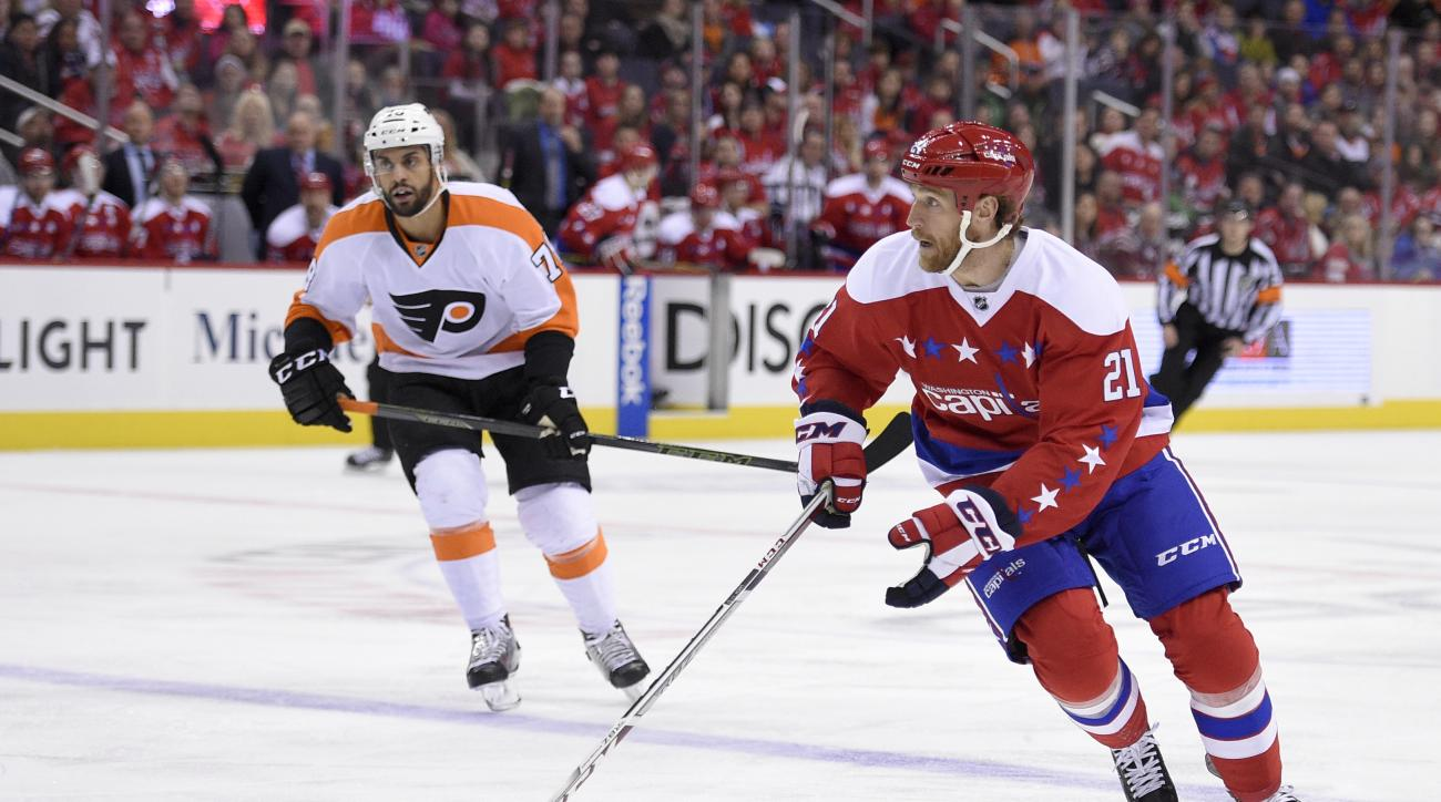 In this photo taken Feb. 7, 2016, Washington Capitals center Brooks Laich (21) skates with the puck during the first period of an NHL hockey game against the Philadelphia Flyers in Washington. The breakup was an emotional one between the Washington Capita