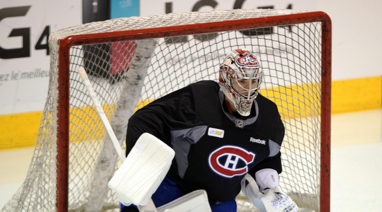 FILE - In this March 1, 2016, file photo, Montreal Canadiens goaltender Carey Price works out at the team's NHL hockey practice facility, in Brossard, Quebec. The United States, Canada and the six other teams playing in the 2016 World Cup of Hockey have n