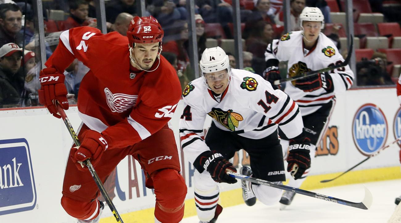 Detroit Red Wings' Jonathan Ericsson (52), of Sweden, is pursued by Chicago Blackhawks' Richard Panik, of Slovakia, during the first period of an NHL hockey game Wednesday, March 2, 2016, in Detroit. (AP Photo/Duane Burleson)