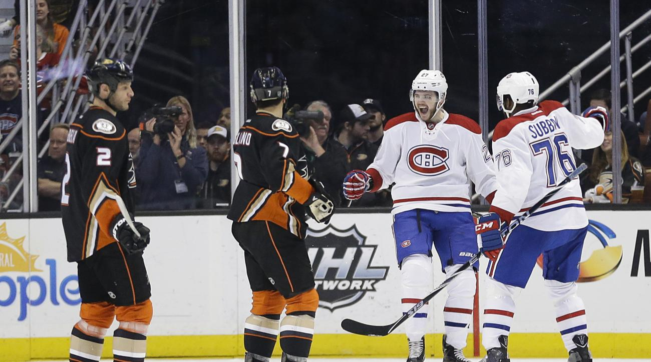 Montreal Canadiens' Alex Galchenyuk, second from right, celebrates his goal with P.K. Subban, right, as Anaheim Ducks' Kevin Bieksa, left, and Andrew Cogliano watch during the second period of an NHL hockey game Wednesday, March 2, 2016, in Anaheim, Calif