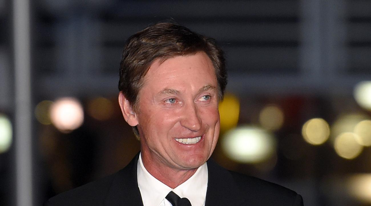 FILE - In this March 7, 2015 file photo, former Kings player Wayne Gretzky speaks to the crowd at a statue unveiling for former Kings left wing Luc Robitaille prior to an NHL hockey game against the Pittsburgh Penguins in Los Angeles. Gretzky, the NHL's a