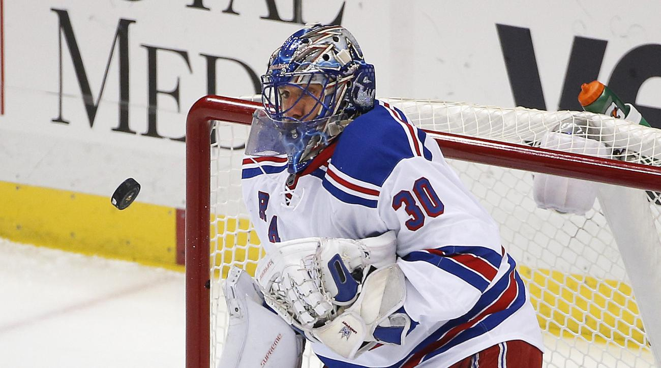New York Rangers goalie Henrik Lundqvist (30) keeps his eye on a rebound during the first period of an NHL hockey game against the Pittsburgh Penguins in Pittsburgh, Thursday, March 3, 2016. (AP Photo/Gene J. Puskar)