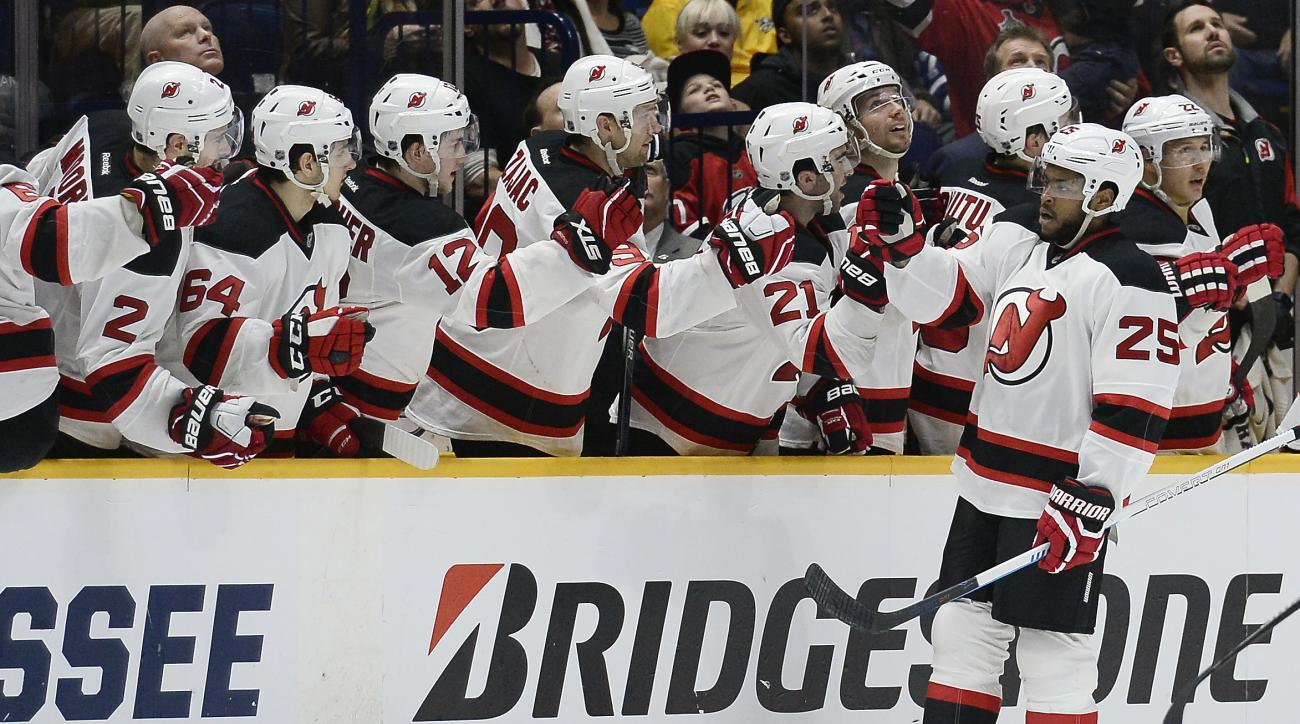 New Jersey Devils right wing Devante Smith-Pelly (25) is congratulated after scoring a goal against the Nashville Predators during the second period of an NHL hockey game Thursday, March 3, 2016, in Nashville, Tenn. (AP Photo/Mark Zaleski)