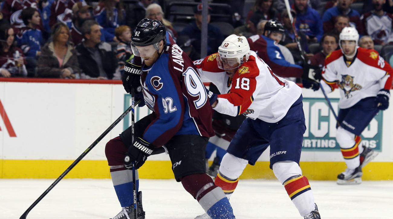 Colorado Avalanche left wing Gabriel Landeskog, left, of Sweden, drives for a shot as Florida Panthers right wing Reilly Smith defends in the second period of an NHL hockey game Thursday, March 3, 2016, in Denver. (AP Photo/David Zalubowski)