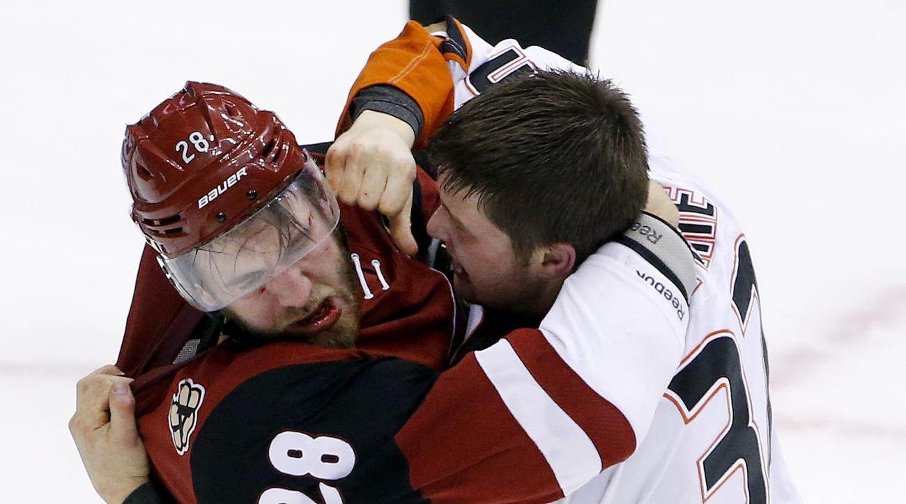 Anaheim Ducks' Nick Ritchie, right, fights with Arizona Coyotes' Jarred Tinordi (28) during the third period of an NHL hockey game Thursday, March 3, 2016, in Glendale, Ariz. The Ducks defeated the Coyotes 5-1. (AP Photo/Ross D. Franklin)
