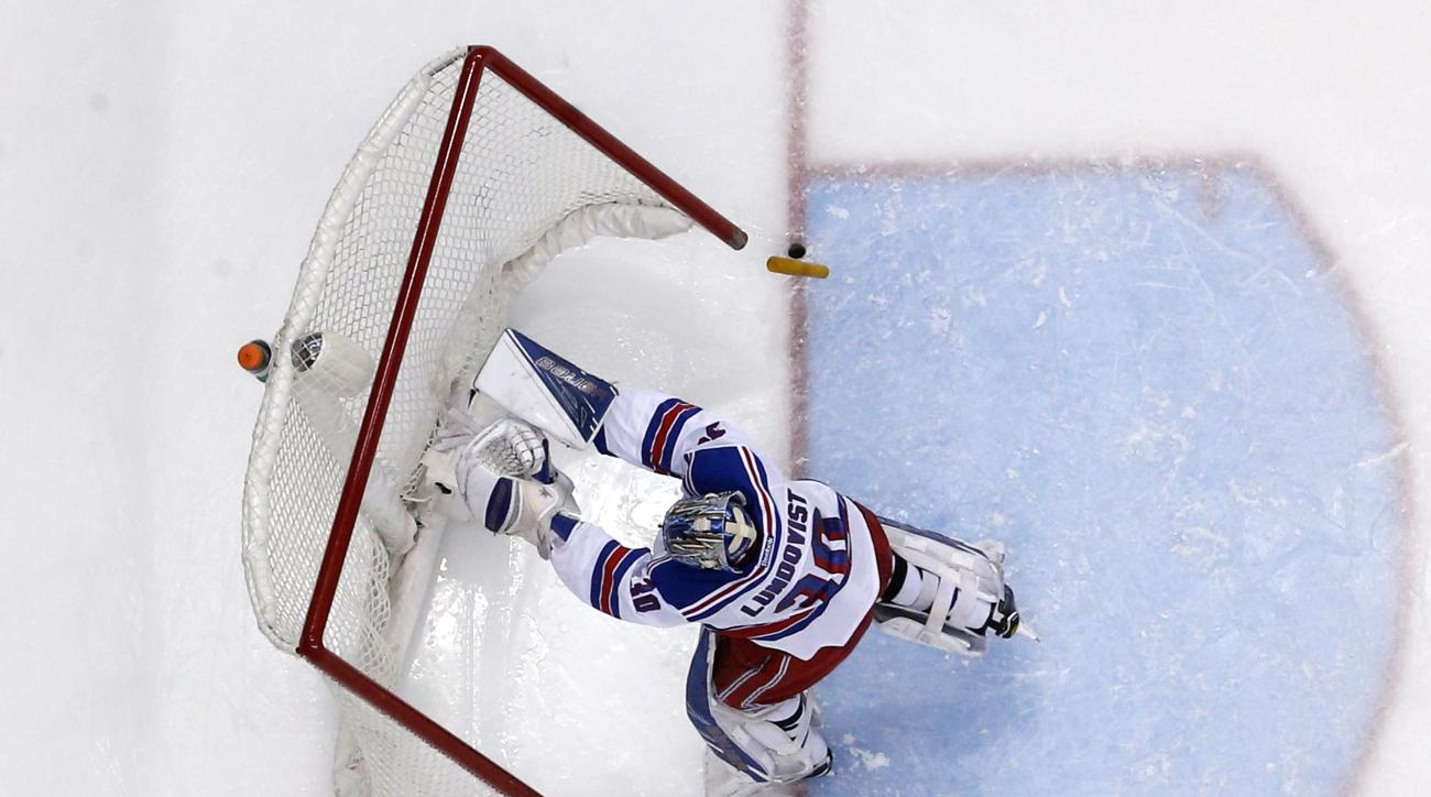 New York Rangers goalie Henrik Lundqvist (30) pushes over the goal cage to force a stoppage of play after being shaken up in a collision with teammate Ryan McDonagh during the second period an NHL hockey game against the Pittsburgh Penguins in Pittsburgh,