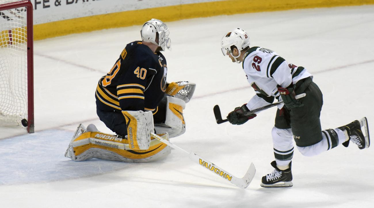 Buffalo Sabres goaltender Robin Lehner (40) gets beat as Minnesota Wild left winger Jason Pominville (29) for the game-winning goal in a shootout during an NHL hockey game, Saturday, March 5, 2016, in Buffalo, N.Y.  Minnesota won 3-2 in a shootout. (AP Ph
