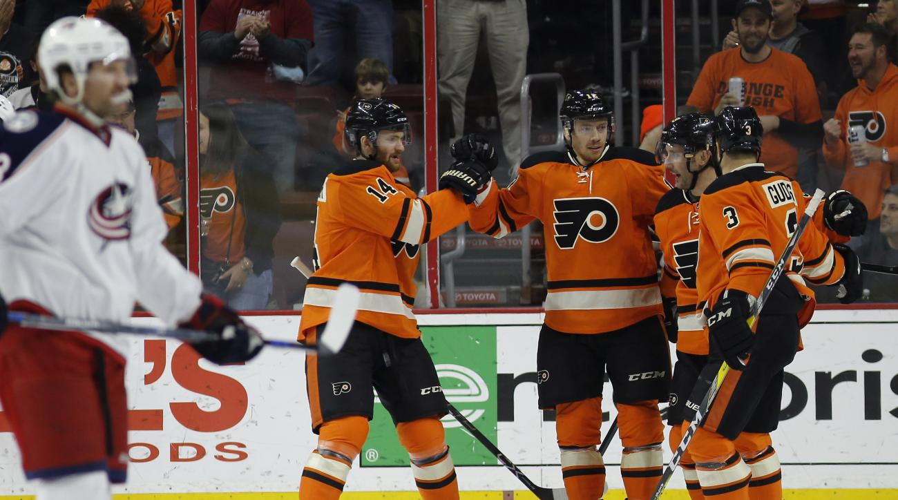 Philadelphia Flyers' Radko Gudas, from right, Sam Gagner, Michael Raffl and Sean Couturier celebrate after Raffl's goal during the first period of an NHL hockey game against the Columbus Blue Jackets, Saturday, March 5, 2016, in Philadelphia. (AP Photo/Ma