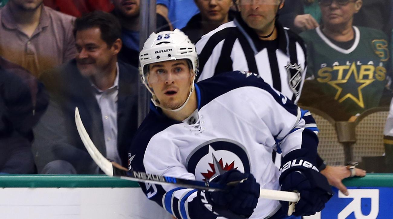 Winnipeg Jets' Mark Scheifele (55) passes against the Dallas Stars during an NHL hockey game, Thursday, Jan. 7, 2016, in Dallas. (AP Photo/Mike Stone)