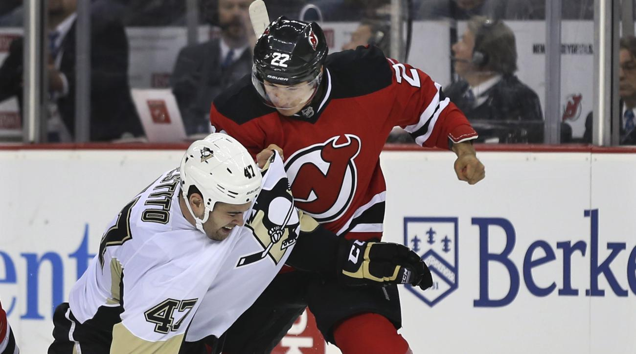 New Jersey Devils right wing Jordin Tootoo (22) fights with Pittsburgh Penguins left wing Tom Sestito (47) during the first period of an NHL hockey game Sunday, March 6, 2016, in Newark, N.J. (AP Photo/Mel Evans)