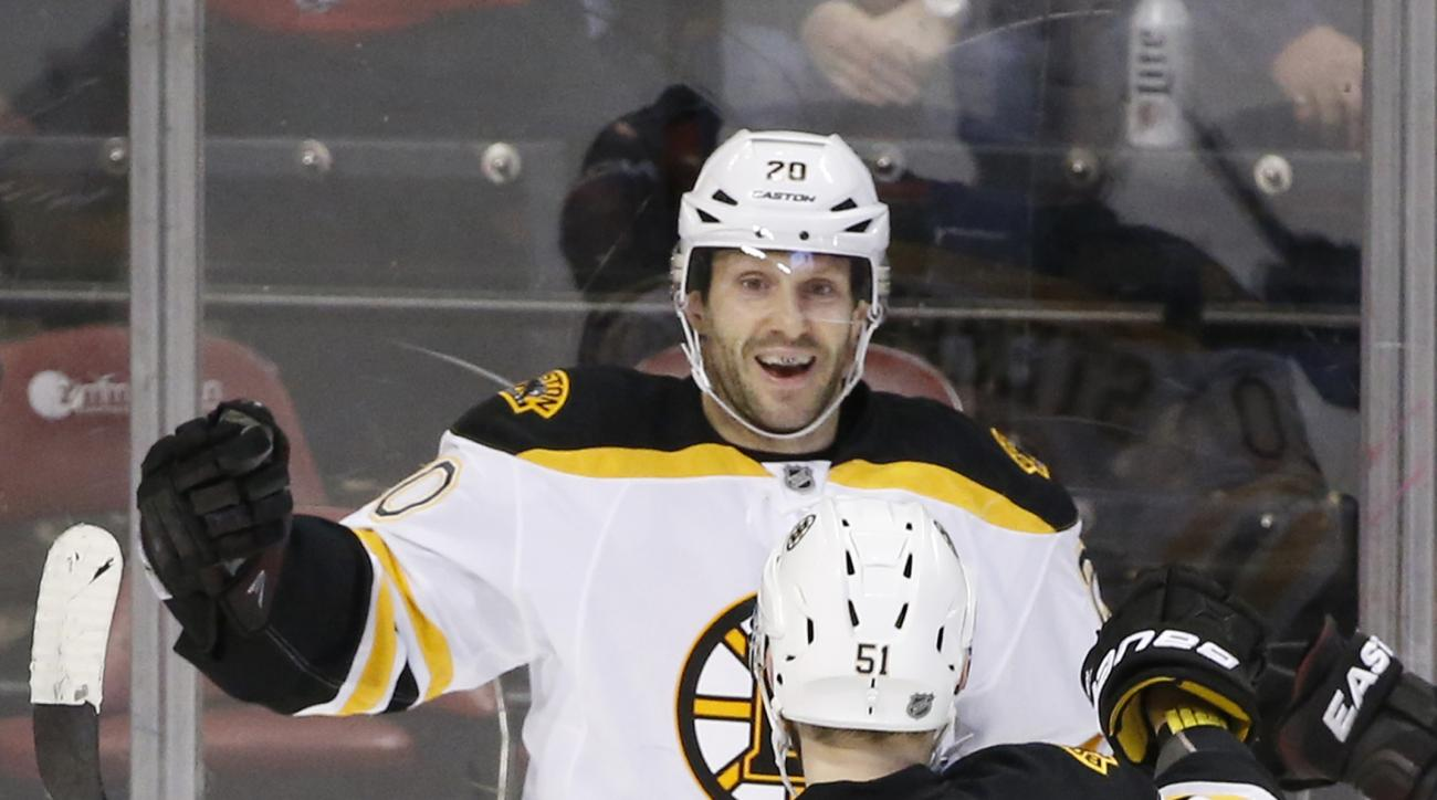 Boston Bruins right wing Lee Stempniak (20) and center Ryan Spooner (51) celebrate after Stempniak scored during an overtime period of an NHL hockey game against the Florida Panthers, Monday, March 7, 2016 in Sunrise, Fla. The Bruins defeated the Panthers