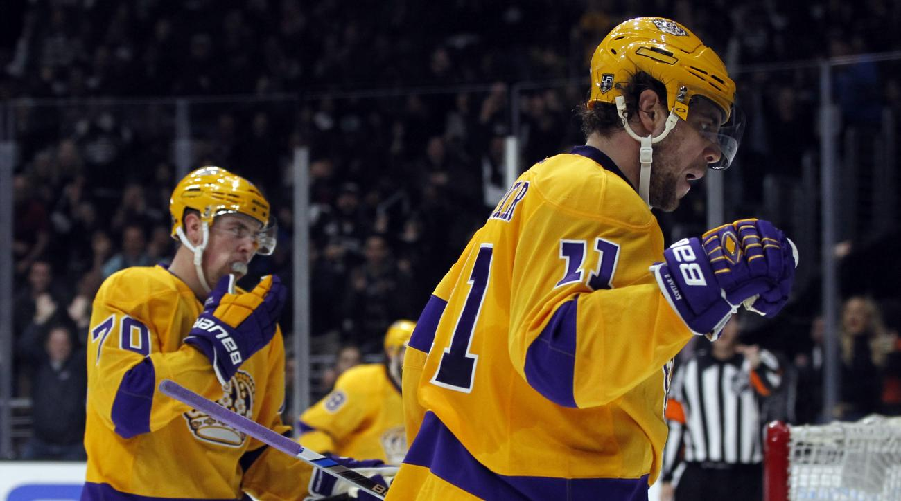 Los Angeles Kings center Anze Kopitar (11), of Slovenia, reacts after scoring against the Vancouver Canucks with left wing Tanner Pearson (70) during the second period of an NHL hockey game in Los Angeles, Monday, March 7, 2016. (AP Photo/Alex Gallardo)