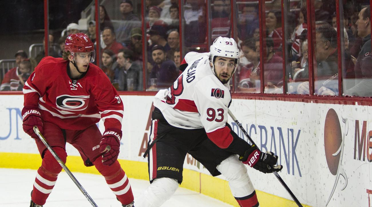 Ottawa Senators' Mika Zibanejad (93) handles the puck as Carolina Hurricanes' Noah Hanifin (5) watches during the first period of an NHL hockey game in Raleigh, N.C., Tuesday, March 8, 2016. (AP Photo/Ben McKeown)