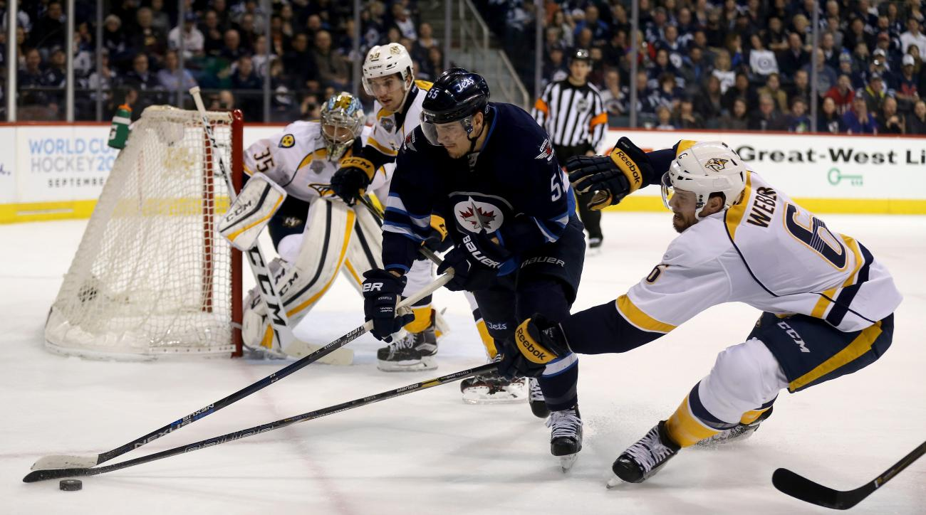 Winnipeg Jets' Mark Scheifele (55) battles with Nashville Predators' Roman Josi (59) and Shea Weber (6) during the second period of an NHL hockey game Tuesday, March 8. 2016, in Winnipeg, Manitoba. (Trevor Hagan/The Canadian Press via AP)