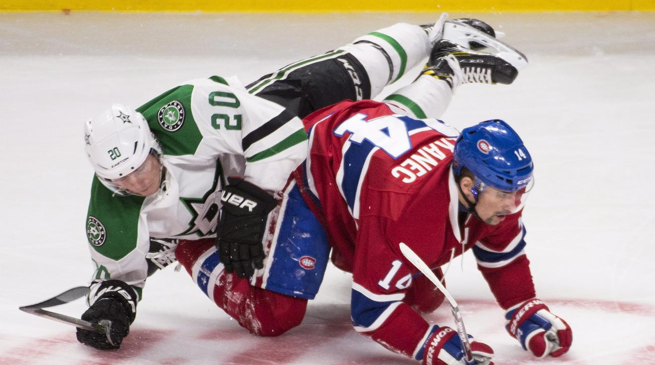 Montreal Canadiens' Tomas Plekanec (14) collides with Dallas Stars' Cody Eakin during the third period of an NHL hockey game Tuesday, March 8. 2016, in Montreal. (Graham Hughes/The Canadian Press via AP)